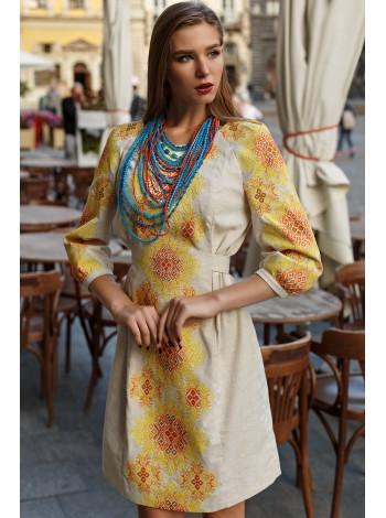 Чарівна жіноча сукня із вишивкою у жовтих тонах