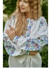 Біла вишита сукня із квітковим візерунком